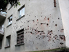 Abkhazia - Sukhumi: bullet holes on a wall - photo by A.Kilroy