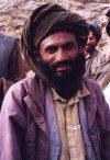 Afghanistan: Kuchi man wearing a turban - a Kuchi is a transhumant or nomadic pastoralist - photo by Anne Dinnan