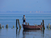Pogradec, Kor�� County, Albania: Ohrid Lake - a boy and his boat - photo by J.Kaman