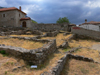 Kruje, Durres County, Albania: ruins and dark sky - photo by J.Kaman