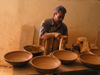 Algeria / Algerie - M'chouneche - Biskra wilaya: pottery workshop - potter at work - photo by J.Kaman
