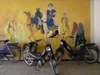 Algeria / Algerie - M'chouneche: mopeds and camel riders - wall mural - photo by J.Kaman