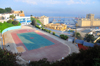 Oran, Algeria / Algérie: oval track surrounding a handball field - view over the harbour, Quai Ste. Thérése - photo by M.Torres |  piste ovale entourant un terrain de handball - vue sur le port