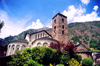 Andorra la Vella: St Esteve Church / Esgl�sia de St. Esteve - tower and three Romanesque apses and a medieval belfry altered by architect Josep Puig i Cadafalch in 1940 - photo by M.Torres