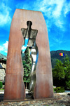 Andorra la Vella, Andorra: Tribute to the men and women of Andorra - Homenatge als homes i dones d'Andorra - sculpture by Emili Armengol i Abril - Carrer de la Vall - Inaugurated by Joan Mart� Alan�s and Fran�ois Mitterrand - modern sculpture with human silhouettes - photo by M.Torres