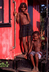 Angola - Luanda - kids near a red railroad car, their house - mi�dos junto a uma carruagem ferrovi�ria vermelha, a sua casa - images of Africa by F.Rigaud