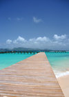 Blowing Point, Anguilla: old wooden pier, Saint Martin in the background - photo by M.Torres