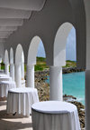 Maundays Bay, West End Village, Anguilla: empty tables by the sea - arcade at Cap Juluca five-star resort - photo by M.Torres