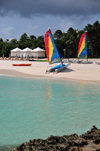 Maundays Bay, West End Village, Anguilla: white sand beach with turqoise water - mini-catamarans and beach gazebos - Cap Juluca five-star resort - photo by M.Torres
