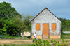The Valley, Anguilla: old wooden building with shingles - former primary school - photo by M.Torres