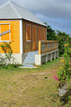 The Valley, Anguilla: orange cottage with zinc roof - Carribbean dwelling, Anguillean charm - photo by M.Torres