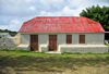 The Valley, Anguilla: old house with cistern - white-washed building with red roof - photo by M.Torres