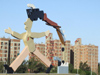 Argentina - Córdoba - modern art - statue with AIDS ribbon against residential blocks - images of South America by M.Bergsma