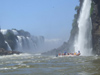 Argentina - Iguazu Falls - Zodiac under the falls - images of South America by M.Bergsma