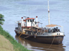 Argentina - Puerto Iguazu - barge on Iguazu River - images of South America by M.Bergsma