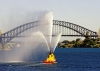 Australia - Sydney (NSW): tug boat show and Harbour Bridge - water jets (photo by A.Walkinshaw)