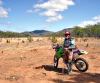 Wakooka Station (Queensland): bike rider and ant hills (photo by Luca Dal Bo)