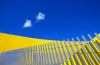 Australia - Melbourne (Victoria): abstract - fence agains yellow background - photo by  Picture Tasmania/Steve Lovegrove