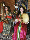Azerbaijan - Baku: Niyazi House Museum - Azeri women in traditional costume playing local instruments (photo by Galen Frysinger)