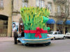 Baku, Azerbaijan: Novruz decoration in the city - a man looks at a giant Semeni, sprouting wheat - photo by N.Mahmudova