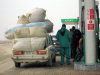 Salyan road, Azerbaijan: petrol station - overloaded car - Lada - photo by F.MacLachlan