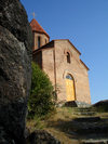Azerbaijan - Qax rayon - Georgian Church above the old Qax Sheki Road - facade and rocks - photo by F.MacLachlan
