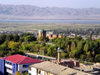 Nakhchivan city, Azerbaijan: city seen from a roof toop - minaret, mausoleum of Momine Khatun, Aras river and Iranian mountains in the distance - photo by K.Jafarli
