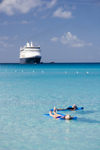 26 Bahamas - Half Moon Cay - Cruise ship passengers on water matresses at Half Moon cay, Bahamas with Holland America cruise ship ms Veendam in background (photo by David Smith)