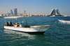 Muharraq Island, Bahrain: looking the the Manama skyline - twin outboard engine boat - photo by M.Torres