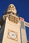 Manama, Bahrain: Abdulla  Ali Yateem Mosque - square minaret with four clocks and decorated with muqarnas - photo by M.Torres