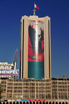 Manama, Bahrain: car park building and National Bank of Bahrain - the King's image in giant format - photo by M.Torres