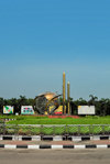 Dakha / Dacca, Bangladesh: roundabout at Hazrat Shahjalal International Airport, formerly Zia International Airport - world and missiles / minarets - photo by M.Torres