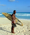 Barbados: surfer with board (photo by P.Baldwin)