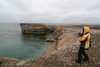 Bear Island / Bj�rn�ya, Svalbard: visitor on the bird cliffs, above a beach - photo by R.Behlke