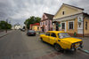 Mir, Karelicy raion, Hrodna Voblast, Belarus: yellow car, bank, street and Orthodox church of the Holy Trinity - photo by A.Dnieprowsky