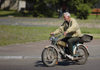 Nesvizh / Nyasvizh, Minsk Voblast, Belarus: man on a rickety motorbike - photo by A.Dnieprowsky