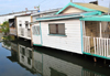 Belize City, Belize: houses hanging over the Southside Canal - West Canal St. - photo by M.Torres