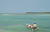 Belize - Caye Caulker - Ambergris Caye: me, my God, my dreams - canoe - lonely fisherman on the caribean sea - Caribbean Sea - photo by C.Palacio