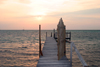 Belize - Caye Caulker: setting with the sun - pier and Caribbean Sea - photo by C.Palacio