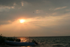Belize - Seine Bight, Placencia peninsula, Stann Creek District: boat at sunset - photo by Charles Palacio