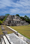 Altun Ha Maya city, Belize District, Belize: Temple of the Masonry Altars, dedicated to the Sun God, Kinich Ahau, patron God of Uxmal and father of Itzamna, lord of night and day - Plaza B - seen from structure A-4 - photo by M.Torres