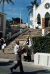 Bermudas - St. George: St Peter's Anglican church, built in 1615 by Bermuda�s first governor, Richard Moore - Church of England - man leading the procession - photo by G.Frysinger