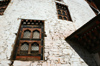 Bhutan - Paro: wall of Bhutan's national museum - windows - photo by A.Ferrari