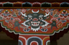 Bhutan - Thimphu - horned demon - painting on support column - city center - photo by A.Ferrari
