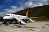 Bhutan - Paro: Druk Air Airbus A319-100 on the ramp, upon arrival in Paro airport - Royal Bhutan Airlines - KB - photo by A.Ferrari