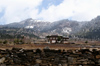 Bhutan - Ura valley - House and mountains covered with snow - photo by A.Ferrari