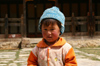 Bhutan - Ura village - Child outside the Geyden Lhakhang - photo by A.Ferrari