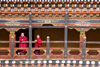 Bhutan, Paro: Monks on balcony of inner courtyard of Paro Dzong - photo by J.Pemberton