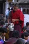Bhutan, Paro: a monk distributes tea to pilgrims - photo by J.Pemberton