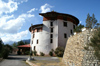 Bhutan - Paro: Bhutan's national museum - ancient Ta-dzong building - photo by A.Ferrari